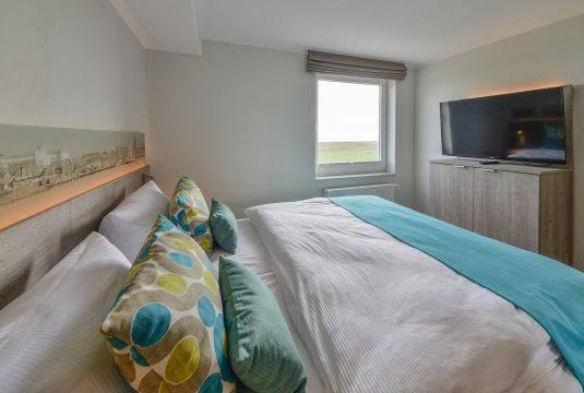 Doppelbett im Appartment Kachelot auf der Insel Juist