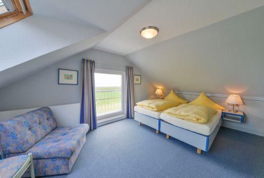 Doppelbett im Appartment Süderoog von Meyenburg & Gerds Höft auf Juist