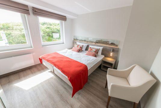Doppelbett im Appartment Memmertsand von Meyenburg & Gerds Höft auf Juist